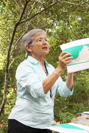 Photo of Donna Ware giving a presentation on the Flora